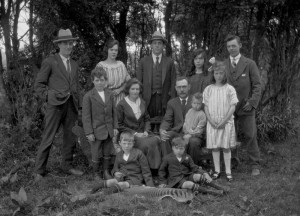 Penney family, Waratah, Tasmania, mid-1920s, with thylacine killer Clem Penney far right at back, and his stripy doormat in the foreground. JH Robinson photo courtesy of Tasmanian Museum and Art Gallery.