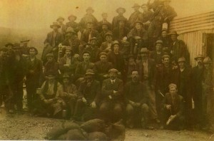 The workforce of the Copper Reward mine, with William Murray centre at front, and engine driver William McArthur seated to his left. Photo courtesy of Edie McArthur.